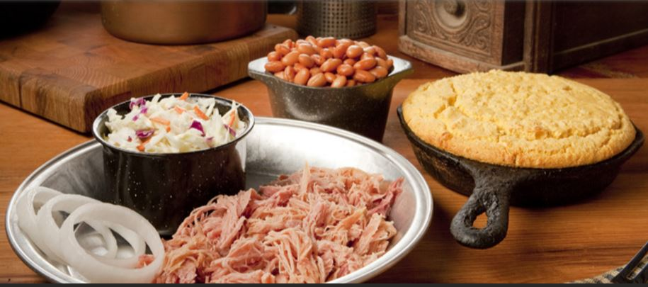 A plate of shredded pork, cole slaw and sides of beans and cornbread at Dollywood's Granny Ogle's restaurant