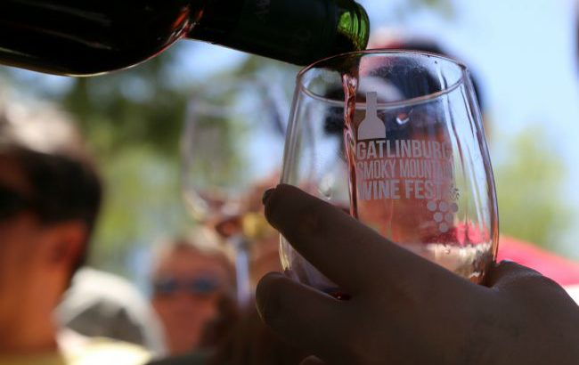 closeup of wine being poured into a branded Gatlinburg Wine Fest glass